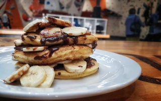 Boardroom pancakes, freshly made served with banana and chocolate
